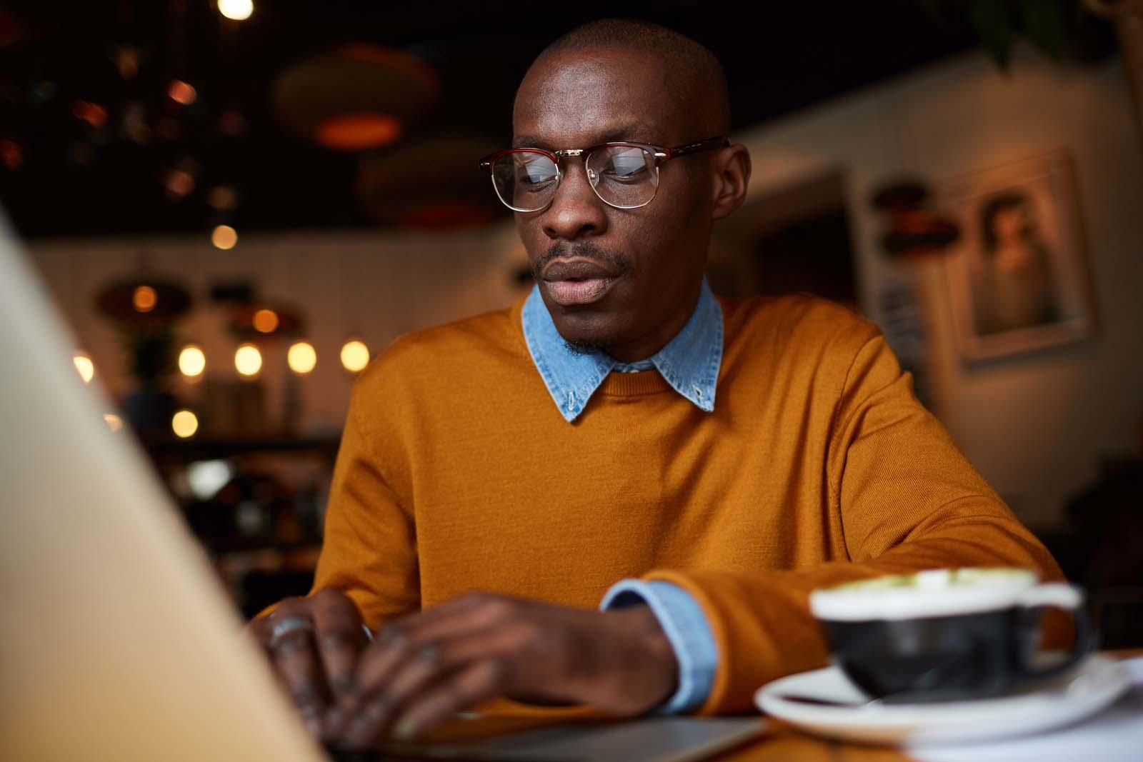freelance guy working hard on his laptop