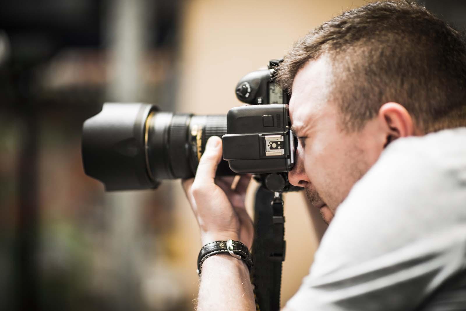 male freelance photographer working