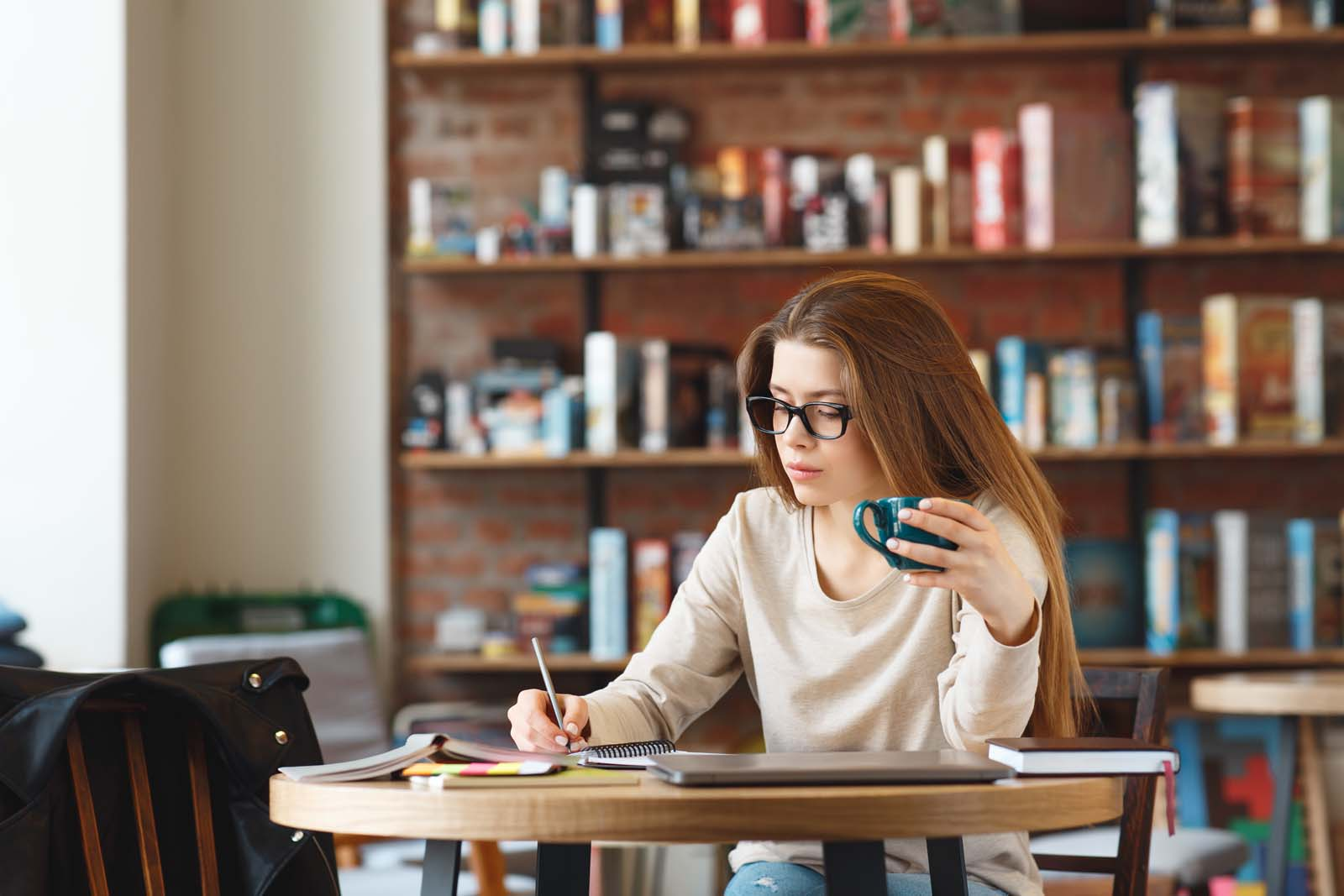 freelance woman drinking coffee and working