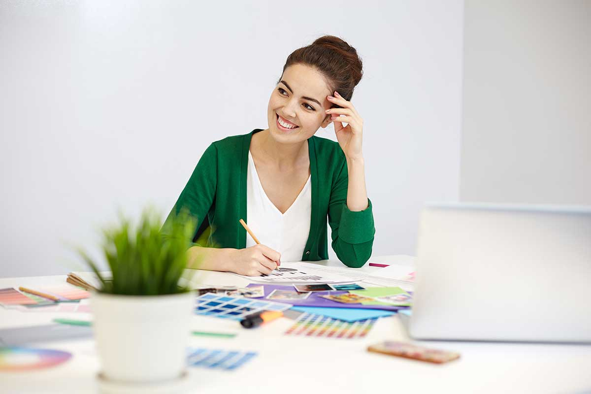 a freelancing woman thinking about design ideas